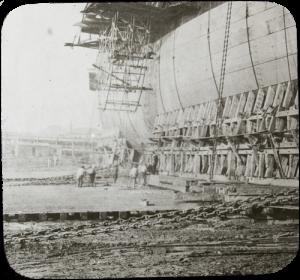 Lantern slide of launching a ship.