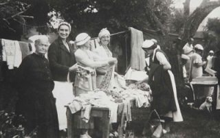 Women swapping stories at summer fete. Oral history. Research Ruth Wade